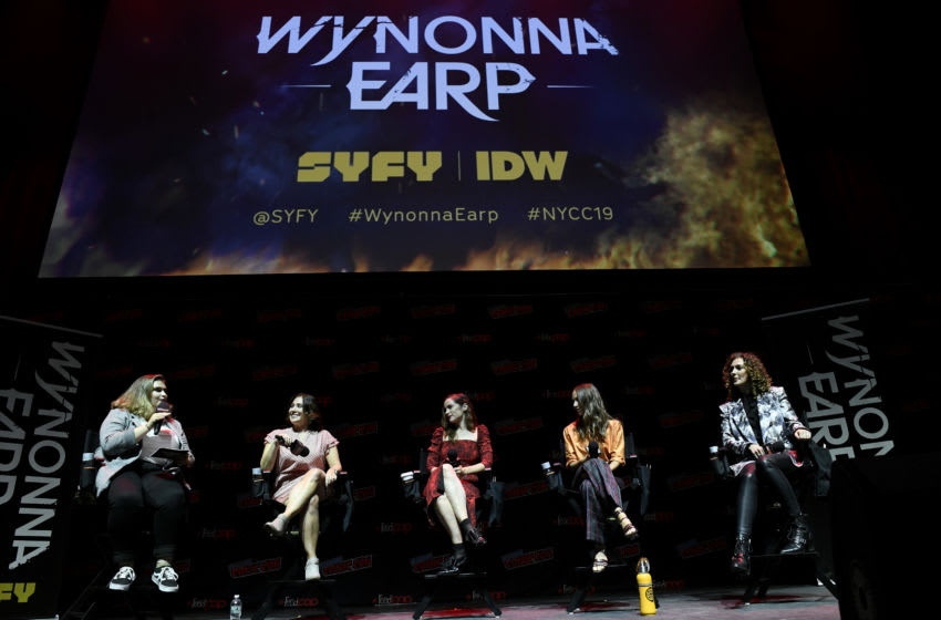 NEW YORK, NEW YORK - OCTOBER 05: Emily Andras, Melanie Scrofano, Dominique Provost-Chalkley and Katherine Barrell speak on stage at SYFY & IDW Entertainment's Wynonna Earp Panel during New York Comic Con 2019 Day 3 at Jacob K. Javits Convention Center on October 05, 2019 in New York City. (Photo by Eugene Gologursky/Getty Images for ReedPOP )