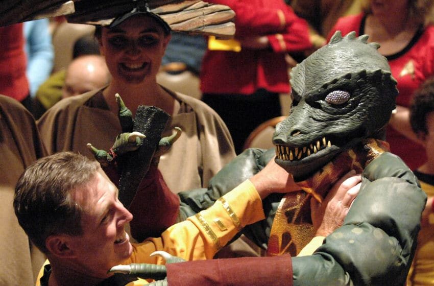 LAS VEGAS, NV - AUGUST 11: Cosplayer dressed as Gorn and cosplayer dressed as Captain Kirk participate in the 11th Annual Official Star Trek Convention - day 3 held at the Rio Hotel & Casino on August 11, 2012 in Las Vegas, Nevada. (Photo by Albert L. Ortega/Getty Images)