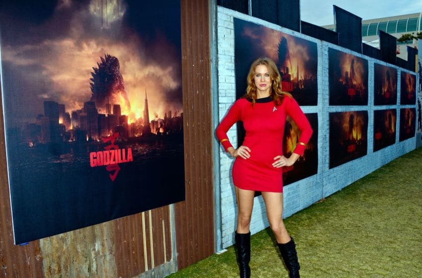 SAN DIEGO, CA - JULY 26: Actress Maitland Ward cosplays a red shirt from 'Star Trek' on Saturday Day 3 of Comic-Con International 2014 at The Godzilla display at The Waterfront Park at The Hilton Bayfront on July 26, 2014 in San Diego, California. (Photo by Albert L. Ortega/Getty Images)