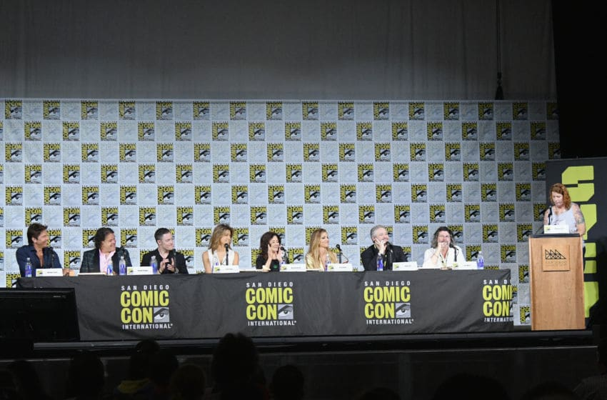 SAN DIEGO, CA - JULY 20: (L-R) Actors Michael Trucco, Aaron Douglas, Tahmoh Penikett, Grace Park, Mary McDonnell, and Tricia Helfer, writers David Eick and Ron Moore, and moderator Maureen Ryan speak onstage at SYFY: