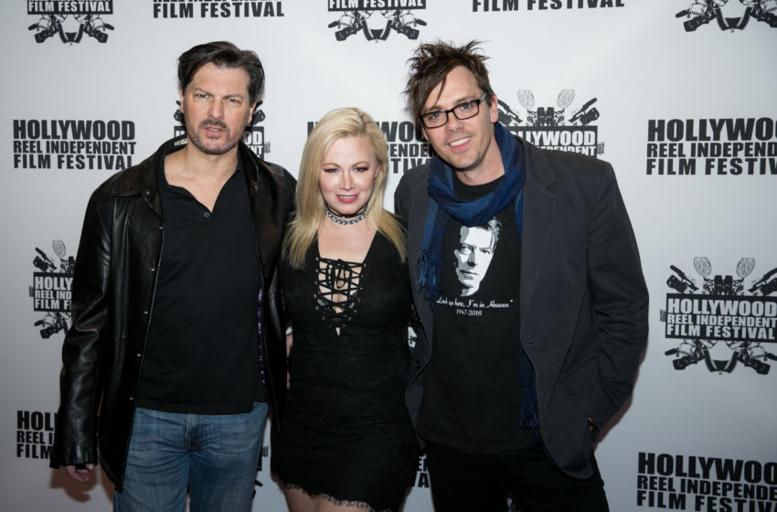 LOS ANGELES, CA - FEBRUARY 27: (L-R) David Hayter, Jessica Cameron and Matthew Currie Holmes arrive at Regal Cinemas L.A. Live on February 27, 2018 in Los Angeles, California. (Photo by John Wolfsohn/Getty Images)
