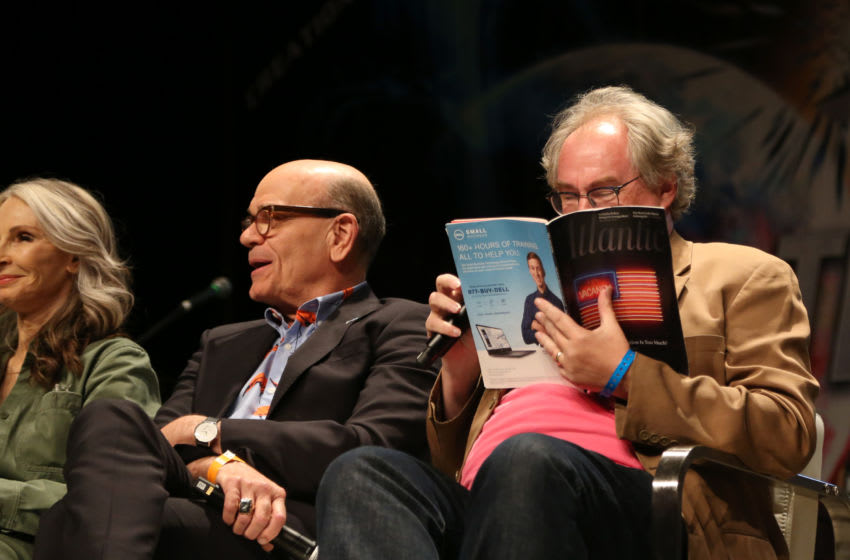 LAS VEGAS, NEVADA - AUGUST 03: (L-R) Actress Gates McFadden and actor Robert Picardo speak as John Billingsley pretends to read a magazine during the