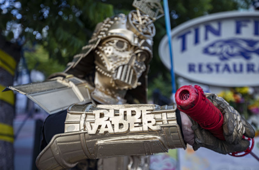 SAN DIEGO, CALIFORNIA - JULY 22: Cosplayer Christopher Canole, dressed as Dude Vader, poses in front of a Comic-Con Memorial on July 22, 2020 in San Diego, California. 2020 Comic-Con International will occur as a virtual event, Comic-Con@Home, due the coronavirus. (Photo by Daniel Knighton/Getty Images)