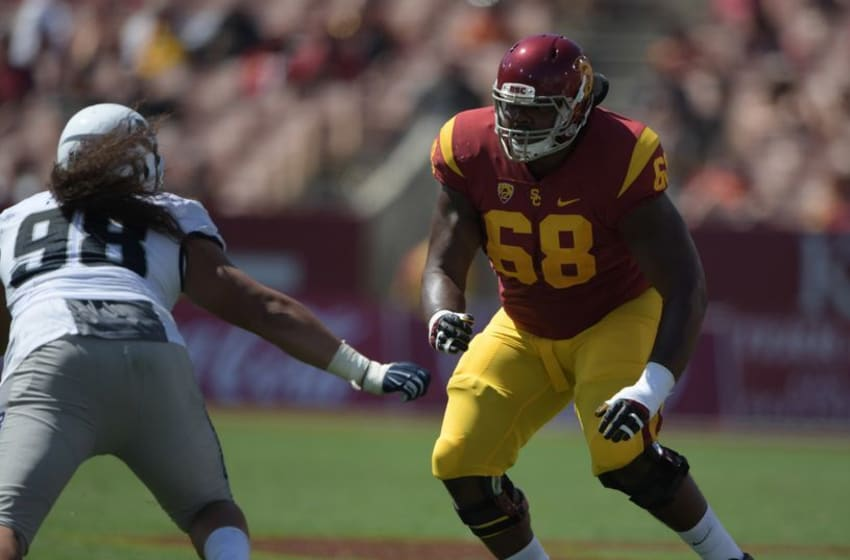 Sep 10, 2016; Los Angeles, CA, USA; USC Trojans guard Jordan Simmons (68) defends against Utah State Aggies defensive end Edmund Faimalo (98) during a NCAA football game at Los Angeles Memorial Coliseum. USC defeated Utah State 45-7. Mandatory Credit: Kirby Lee-USA TODAY Sports