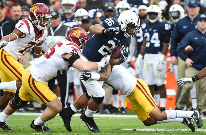 Jan 2, 2017; Pasadena, CA, USA; Penn State Nittany Lions running back Saquon Barkley (26) runs against USC Trojans linebacker Cameron Smith (35) for a 16 yard gain during the second quarter of the 2017 Rose Bowl game at Rose Bowl. Mandatory Credit: Jayne Kamin-Oncea-USA TODAY Sports