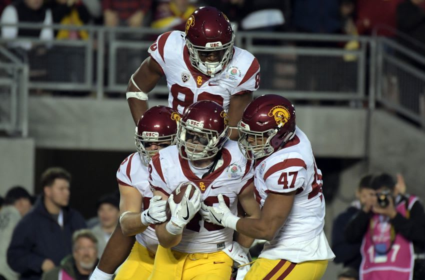 Jan 2, 2017; Pasadena, CA, USA; USC Trojans tight end Taylor McNamara (48) celebrates making a touchdown with fullback Reuben Peters (47) and tight end Daniel Imatorbhebhe (88) during the third quarter of the 2017 Rose Bowl game against the Penn State Nittany Lions at Rose Bowl. Mandatory Credit: Kirby Lee-USA TODAY Sports