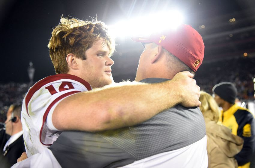 Jan 2, 2017; Pasadena, CA, USA; USC Trojans quarterback Sam Darnold (14) embraces head coach Clay Helton after defeating the Penn State Nittany Lions in the 2017 Rose Bowl game at Rose Bowl. Mandatory Credit: Jayne Kamin-Oncea-USA TODAY Sports