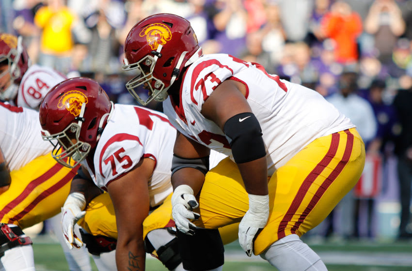 USC football offensive linemen. (Alicia de Artola/Reign of Troy)
