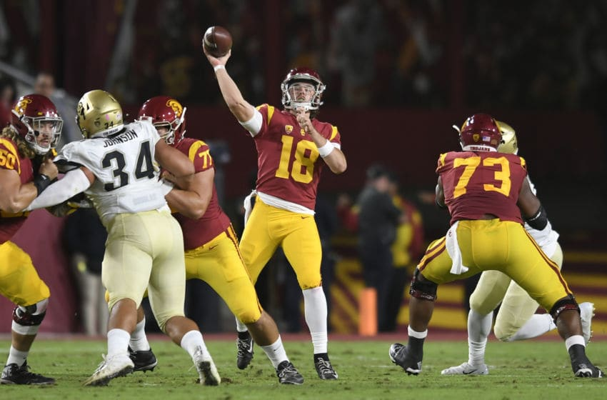 LOS ANGELES, CA - OCTOBER 13: Quarterback JT Daniels #18 of the USC Trojans attempts a pass in the first quarter against the Colorado Buffaloes at Los Angeles Memorial Coliseum on October 13, 2018 in Los Angeles, California. (Photo by John McCoy/Getty Images)