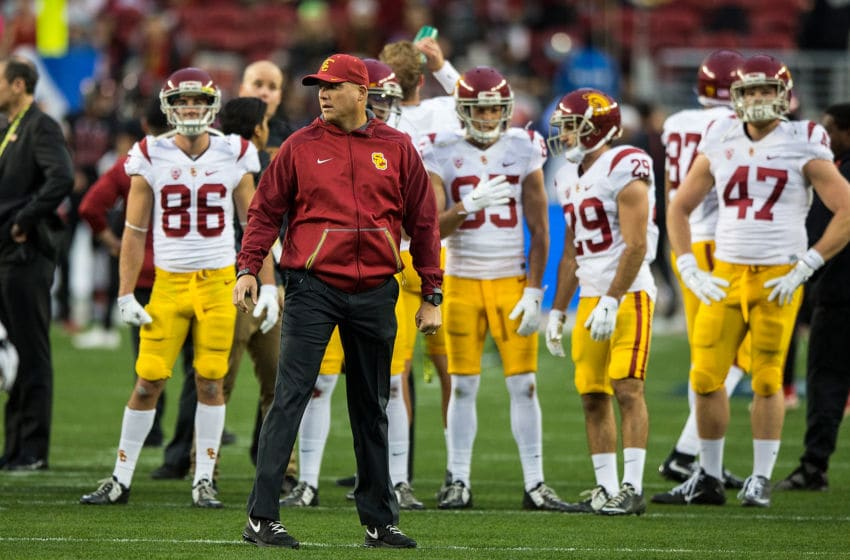 SANTA CLARA, CA - DECEMBER 05: Head coach Clay Helton of the USC Trojans watches his team during warmups before the Pac-12 Championship game against the Stanford Cardinal at Levi's Stadium on December 5, 2015 in Santa Clara, California. (Photo by Jason O. Watson/Getty Images)