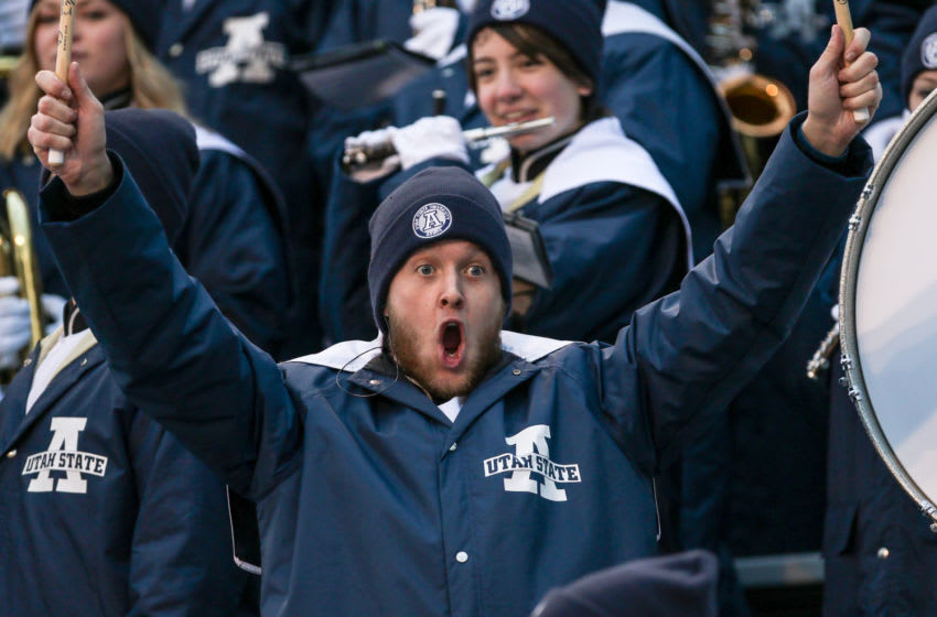 BOISE, ID - DECEMBER 22: A Utah State Aggies fan cheers during second half action at the Famous Idaho Potato Bowl between the Utah State Aggies and the Akron Zips on December 22, 2015 at Albertsons Stadium in Boise, Idaho. Akron won the game 23-21. (Photo by Loren Orr/Getty Images)