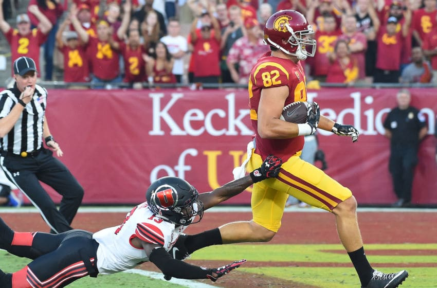 LOS ANGELES, CA - OCTOBER 14: Tight end Tyler Petite #82 of the USC Trojans beats defensive back Marquise Blair #13 of the Utah Utes into the end zone for a touchdown in the first quarter of the game at the Los Angeles Memorial Coliseum on October 14, 2017 in Los Angeles, California. (Photo by Jayne Kamin-Oncea/Getty Images)