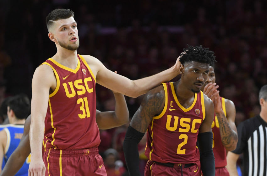 LOS ANGELES, CA - MARCH 07: Nick Rakocevic #31 gives a pat on the head to Jonah Mathews #2 of the USC Trojans during a time out in the game against the UCLA Bruins at Galen Center on March 7, 2020 in Los Angeles, California. (Photo by Jayne Kamin-Oncea/Getty Images)