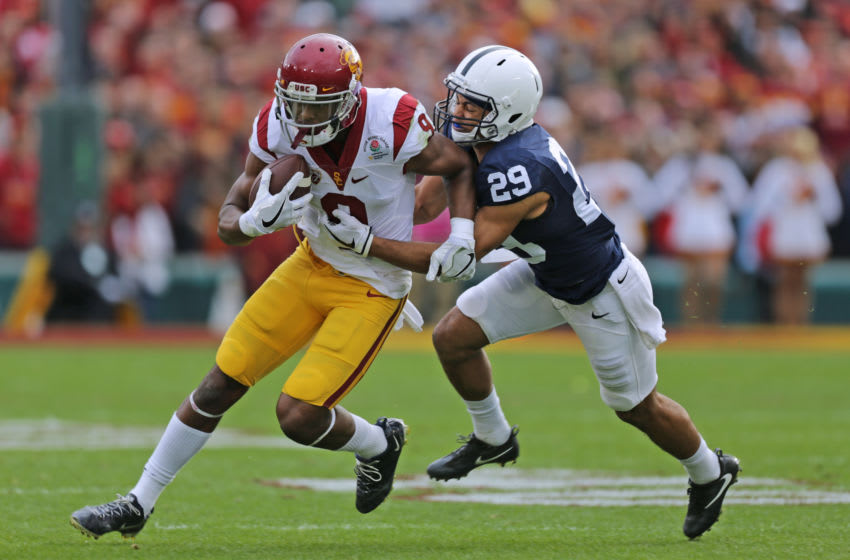 PASADENA, CA - JANUARY 02: Wide receiver JuJu Smith-Schuster #9 of the USC Trojans carries the ball against Corner back John Reid #29 of the Penn State Nittany Lions in the 2017 Rose Bowl Game presented by Northwestern Mutual at Rose Bowl on January 2, 2017 in Pasadena, California. (Photo by Leon Bennett/Getty Images)