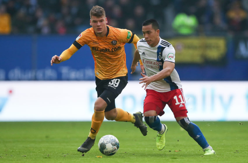 23 November 2019, Hamburg: Soccer: 2nd Bundesliga, 14th matchday, Hamburger SV - Dynamo Dresden in the Volksparkstadion. Hamburg's Bobby Wood (r) and Dresden's Kevin Ehlers in the duel for the ball. Photo: Christian Charisius/dpa - IMPORTANT NOTE: In accordance with the requirements of the DFL Deutsche Fußball Liga or the DFB Deutscher Fußball-Bund, it is prohibited to use or have used photographs taken in the stadium and/or the match in the form of sequence images and/or video-like photo sequences. (Photo by Christian Charisius/picture alliance via Getty Images)