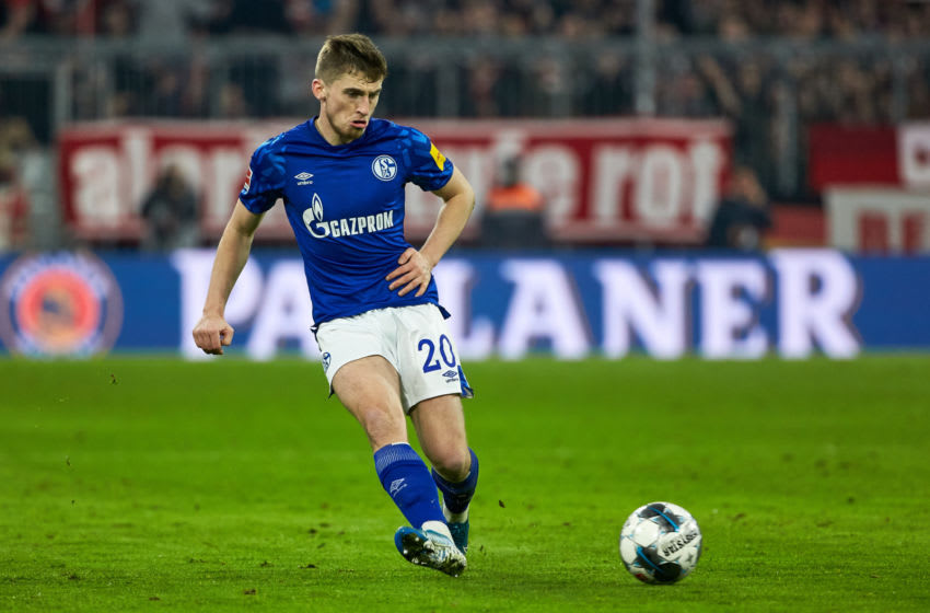 MUNICH, GERMANY - JANUARY 25: (BILD ZEITUNG OUT) Jonjoe Kenny of FC Schalke 04 controls the ball during the Bundesliga match between FC Bayern Muenchen and FC Schalke 04 at Allianz Arena on January 25, 2020 in Munich, Germany. (Photo by TF-Images/Getty Images)
