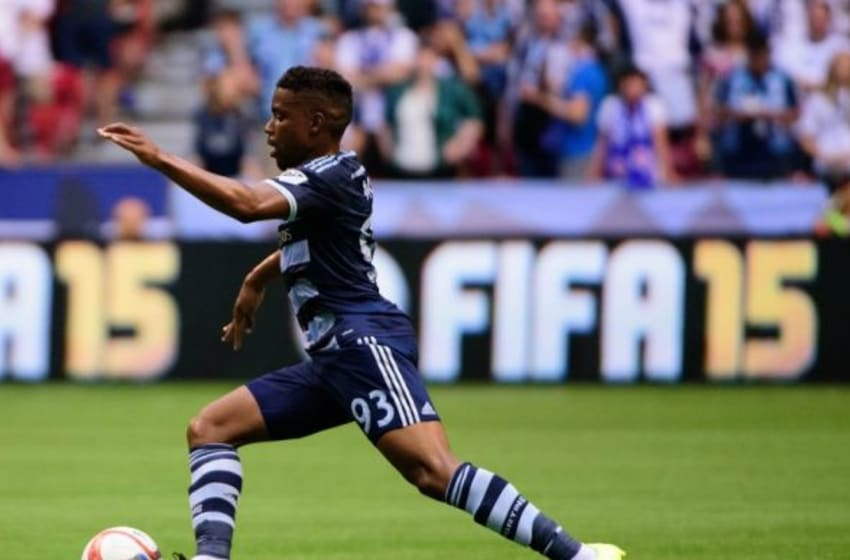 Jul 12, 2015; Vancouver, British Columbia, CAN; Sporting KC midfielder Soni Mustivar (93) controls the ball against the Vancouver Whitecaps during the first half at BC Place. The Sporting KC won 1-0. Mandatory Credit: Anne-Marie Sorvin-USA TODAY Sports