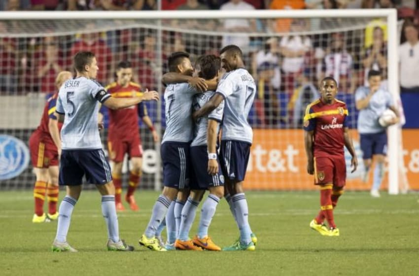 Jul 24, 2015; Sandy, UT, USA; Sporting KC defender Matt Besler (5) and midfielder Roger Espinoza (27) and defender Saad Abdul-Salaam (17) celebrate a goal by midfielder Benny Feilhaber (10) during the second half against Real Salt Lake at Rio Tinto Stadium. Real Salt Lake won 2-1. Mandatory Credit: Russ Isabella-USA TODAY Sports
