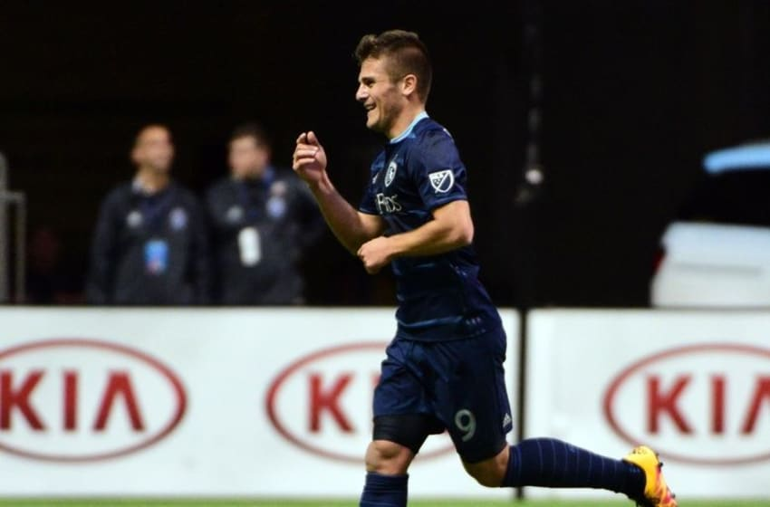 Apr 27, 2016; Vancouver, British Columbia, CAN; Sporting KC forward Diego Rubio (9) celebrates his goal against Vancouver Whitecaps goalkeeper David Ousted (1) (not pictured) during the first half at BC Place. Mandatory Credit: Anne-Marie Sorvin-USA TODAY Sports