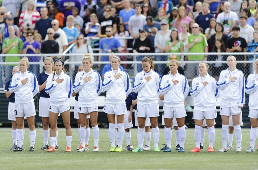 Aug 31, 2014; Tukwila, WA, USA; The FC Kansas City during the National Anthem prior to the game against the Seattle Reign FC at Starfire Soccer Stadium. Kansas City defeated Seattle 2-1. Mandatory Credit: Steven Bisig-USA TODAY Sports