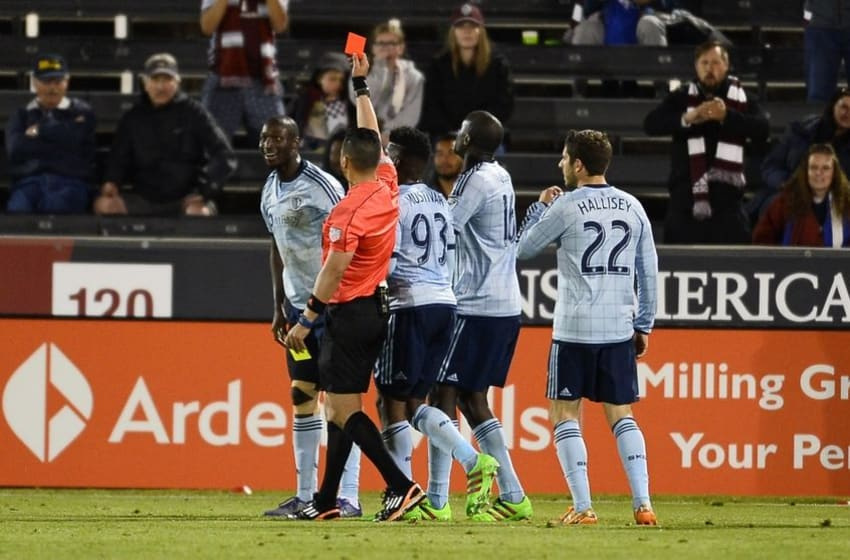 May 11, 2016; Commerce City, CO, USA; Sporting Kansas City defender Ike Opara (3) reacts after receiving a red card ejection by referee Jose Carlos Rivero (C) in the second half against the Colorado Rapids at Dicks Sporting Goods Park. The Rapids won 1-0. Mandatory Credit: Ron Chenoy-USA TODAY Sports