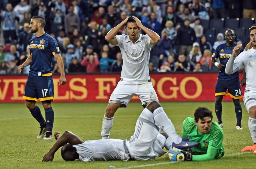 May 1, 2016; Kansas City, KS, USA; Sporting KC mid-fielder Roger Espinoza (27) reacts after defender Ike Opara (3) misses a shot on goal against LA Galaxy goal keeper Brian Rowe (12) during the first half at Children