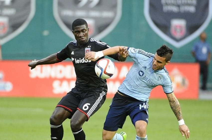 May 9, 2015; Washington, DC, USA; D.C. United defender Kofi Opare (6) and Sporting KC forward Dom Dwyer (14) battle for the ball during the first half at Robert F. Kennedy Memorial. Mandatory Credit: Brad Mills-USA TODAY Sports