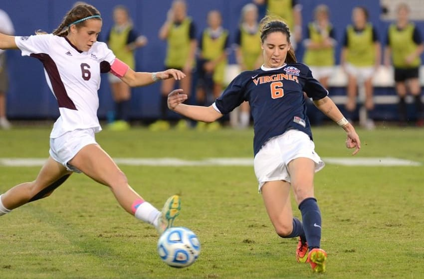 Dec 5, 2014; Boca Raton, FL, USA; Virginia Cavaliers midfielder Morgan Brian (6) and Texas A&M Aggies forward Shea Groom (6) battle for the ball during the first half at FAU Stadium. Mandatory Credit: Jonathan Dyer-USA TODAY Sports