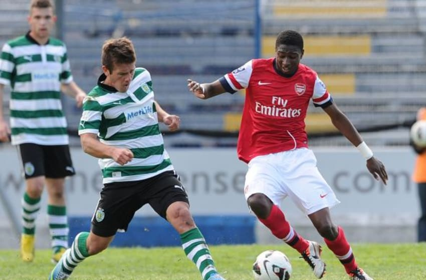 COMO, ITALY - MARCH 31: Alfred Mugabo of Arsenal is challenged by Diego Rubio of Sporting during the NextGen Series 3rd Place Play Off match between Arsenal and Sporting Lisbon at Stadio Giuseppe Sinigallia on March 31, 2013 in Como, Italy. (Photo by David Price/Arsenal FC via Getty Images)
