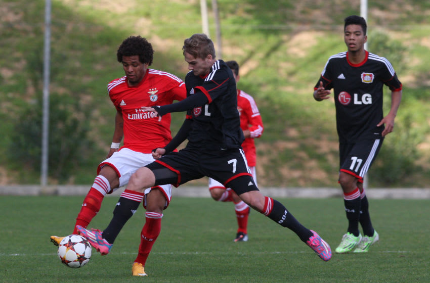 LISBON, PORTUGAL - DECEMBER 9: SL Benfica's midfielder Kevin Oliveira with Bayer Leverkusen's defender Tim Handwerker during the UEFA Youth League match between SL Benfica and Bayer Leverkusen at Caixa Futebol Campus Training Academy on December 9, 2014 in Lisbon, Portugal. (Photo by Gualter Fatia/Getty Images)