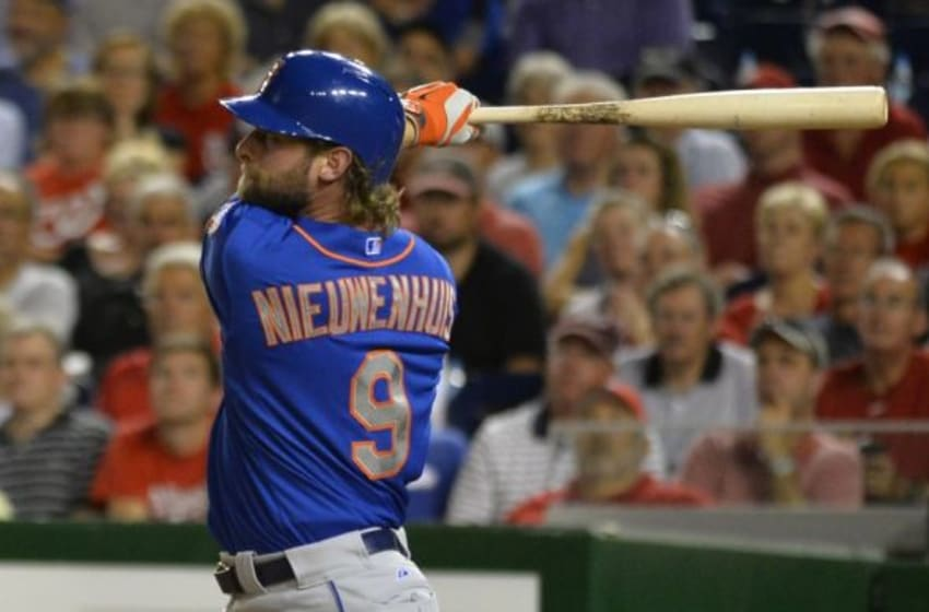 Sep 8, 2015; Washington, DC, USA; New York Mets left fielder Kirk Nieuwenhuis (9) hits a solo home run during the eighth inning against the Washington Nationals at Nationals Park. New York Mets defeated Washington Nationals 8-7. Mandatory Credit: Tommy Gilligan-USA TODAY Sports