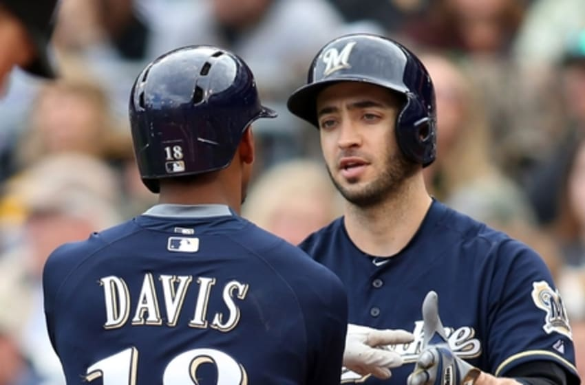 Sep 13, 2015; Pittsburgh, PA, USA; Milwaukee Brewers right fielder Ryan Braun (8) greets left fielder Khris Davis (18) at home plate after Davis hit a two run home run against the Pittsburgh Pirates during the third inning at PNC Park. Mandatory Credit: Charles LeClaire-USA TODAY Sports