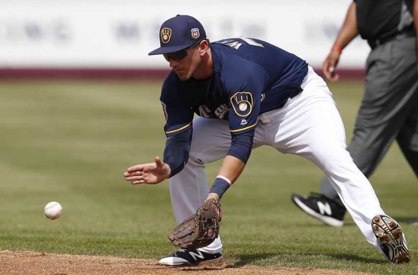 Mar 11, 2016; Phoenix, AZ, USA; Milwaukee Brewers second baseman Colin Walsh (73) fields the ball against the Texas Rangers in the second inning during a spring training game at Maryvale Baseball Park. Mandatory Credit: Rick Scuteri-USA TODAY Sports