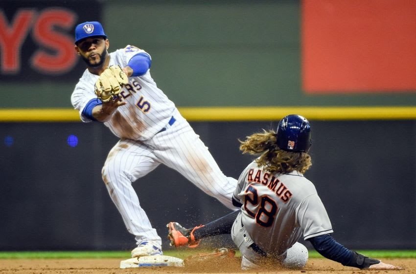 Apr 8, 2016; Milwaukee, WI, USA; Houston Astros left fielder Colby Rasmus (28) is forced out by Milwaukee Brewers shortstop Jonathan Villar (5) and was called for interference resulting in a double play in the ninth inning and ending the game at Miller Park. The Brewers beat the Astros 6-4. Mandatory Credit: Benny Sieu-USA TODAY Sports