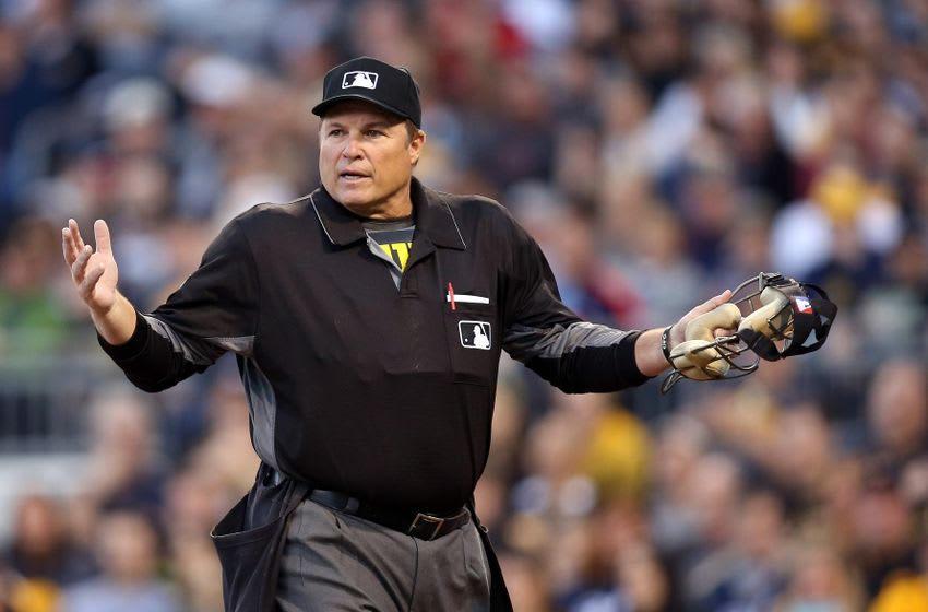 Apr 15, 2016; Pittsburgh, PA, USA; Home plate umpire Marvin Hudson gestures in the game between the Milwaukee Brewers and the Pittsburgh Pirates during the third inning at PNC Park. Mandatory Credit: Charles LeClaire-USA TODAY Sports