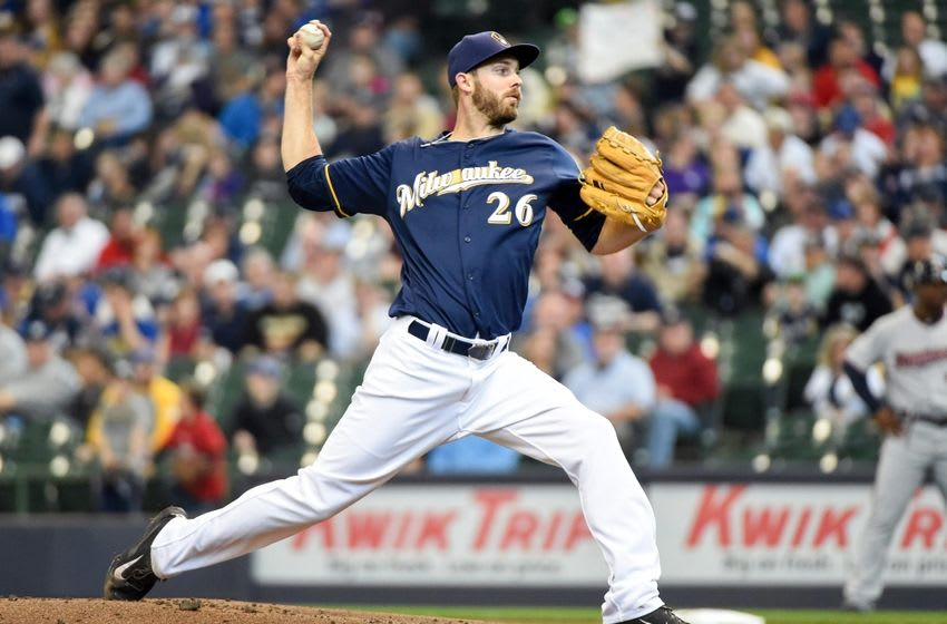 Apr 21, 2016; Milwaukee, WI, USA; Milwaukee Brewers pitcher Taylor Jungmann (26) pitches in the first inning against the Minnesota Twins at Miller Park. Mandatory Credit: Benny Sieu-USA TODAY Sports
