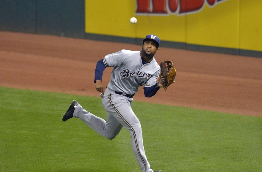 Aug 25, 2015; Cleveland, OH, USA; Milwaukee Brewers right fielder Domingo Santana (16) makes a running catch in the sixth inning against the Cleveland Indians at Progressive Field. Mandatory Credit: David Richard-USA TODAY Sports
