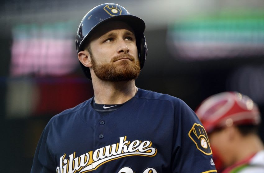 Jul 6, 2016; Washington, DC, USA; Milwaukee Brewers catcher Jonathan Lucroy (20) walks off the field after striking out during the eighth inning against the Washington Nationals at Nationals Park. Washington Nationals defeated Milwaukee Brewers 7-4. Mandatory Credit: Tommy Gilligan-USA TODAY Sports