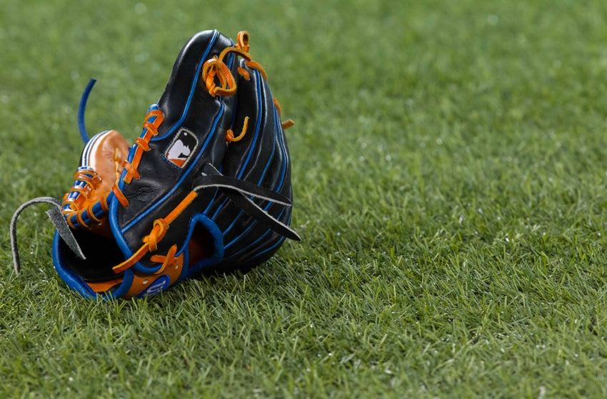 May 5, 2016; Toronto, Ontario, CAN; Baseball glove on turf before an MLB game between the Toronto Blue Jays and Texas Rangers at Rogers Centre. Mandatory Credit: Kevin Sousa-USA TODAY Sports