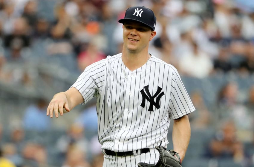 NEW YORK, NY - AUGUST 01: Sonny Gray #55 of the New York Yankees reacts to the booing fans as he is pulled from the game in the third inning against the Baltimore Orioles at Yankee Stadium on August 1, 2018 in the Bronx borough of New York City. (Photo by Elsa/Getty Images)
