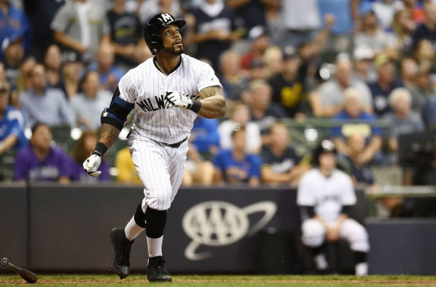 MILWAUKEE, WI - AUGUST 03: Eric Thames #7 of the Milwaukee Brewers hits a three run walk off home run against the Colorado Rockies during the ninth inning of a game at Miller Park on August 3, 2018 in Milwaukee, Wisconsin. (Photo by Stacy Revere/Getty Images)