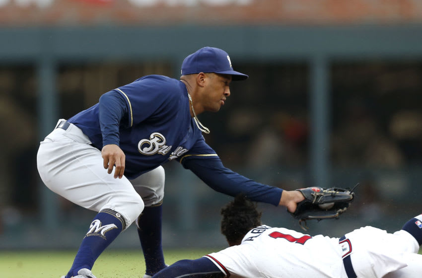 ATLANTA, GA - AUGUST 10: Second baseman Ozzie Albies #1 of the Atlanta Braves slides under the tag of shortstop Jonathan Schoop #5 of the Milwaukee Brewers for a stolen base in the first inning during the game at SunTrust Park on August 10, 2018 in Atlanta, Georgia. (Photo by Mike Zarrilli/Getty Images)