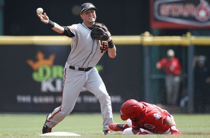 CINCINNATI, OH - AUGUST 19: Joe Panik #12 of the San Francisco Giants turns a double play over Billy Hamilton #6 of the Cincinnati Reds in the first inning at Great American Ball Park on August 19, 2018 in Cincinnati, Ohio. (Photo by Joe Robbins/Getty Images)