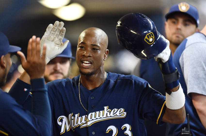 MILWAUKEE, WI - AUGUST 20: Keon Broxton #23 of the Milwaukee Brewers is congratulated by teammates after scoring a run against the Cincinnati Reds during the eighth inning of a game at Miller Park on August 20, 2018 in Milwaukee, Wisconsin. (Photo by Stacy Revere/Getty Images)