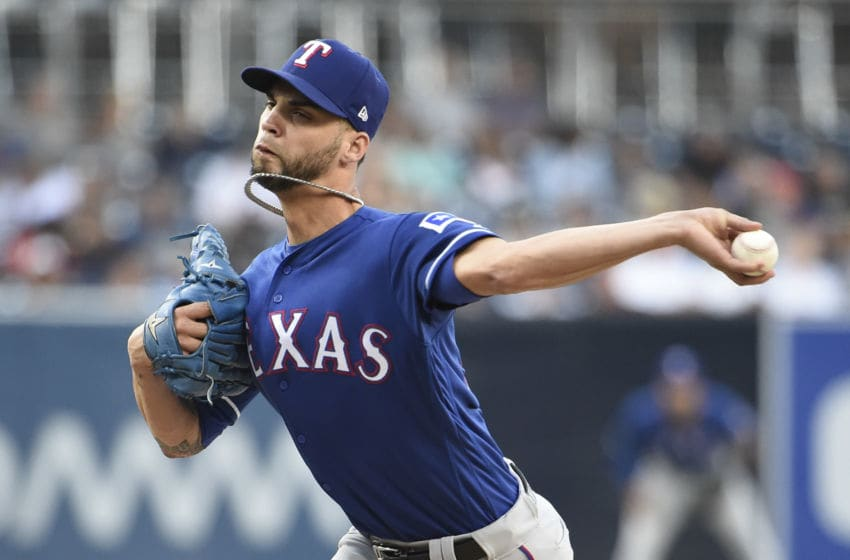 SAN DIEGO, CA - SEPTEMBER 15: Alex Claudio #58 of the Texas Rangers pitches during the first inning of a baseball game against the San Diego Padres at PETCO Park on September 15, 2018 in San Diego, California. (Photo by Denis Poroy/Getty Images)