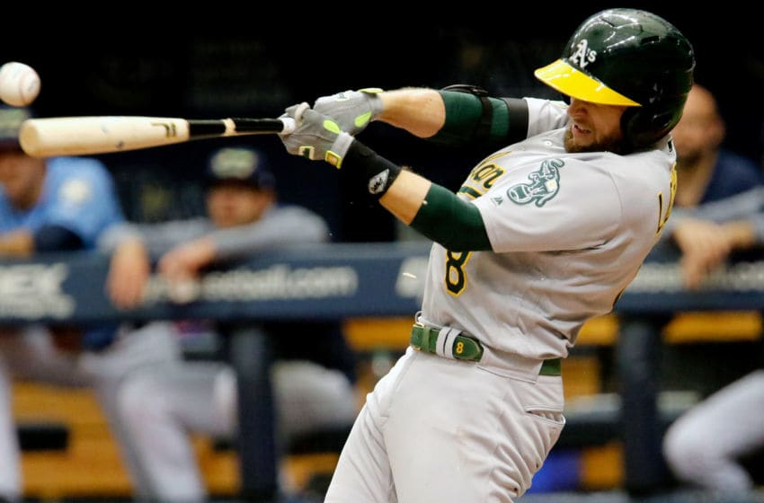 ST. PETERSBURG, FL SEPTEMBER 16: Jed Lowrie #8 of the Oakland Athletics hits a foul ball during the third inning of the game against the Oakland Athletics at Tropicana Field on September 16, 2018 in St. Petersburg, Florida. (Photo by Joseph Garnett Jr./Getty Images)