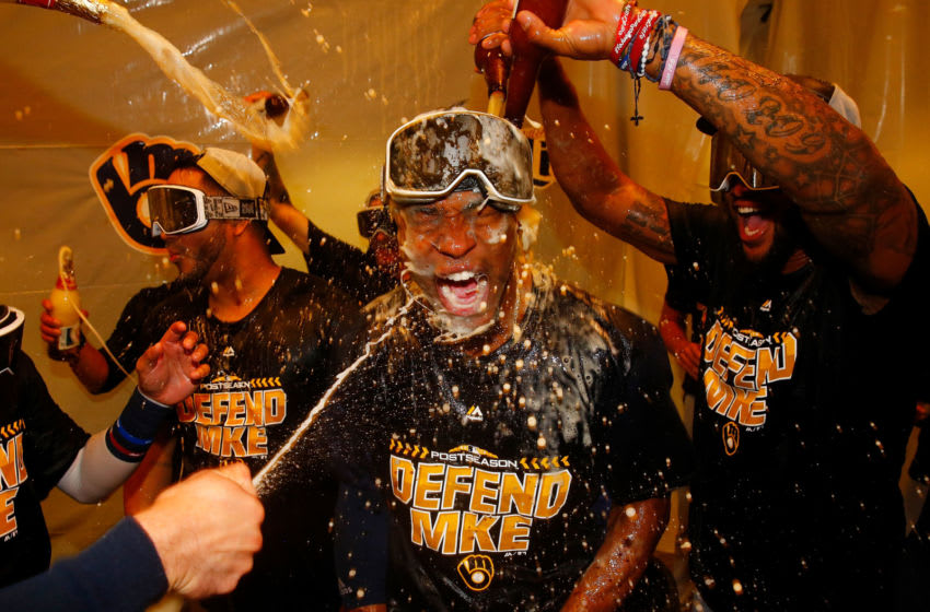 ST. LOUIS, MO - SEPTEMBER 26: Keon Broxton #23 of the Milwaukee Brewers celebrates with his teammates after clinching a post-season birth at Busch Stadium on September 26, 2018 in St. Louis, Missouri. (Photo by Dilip Vishwanat/Getty Images)