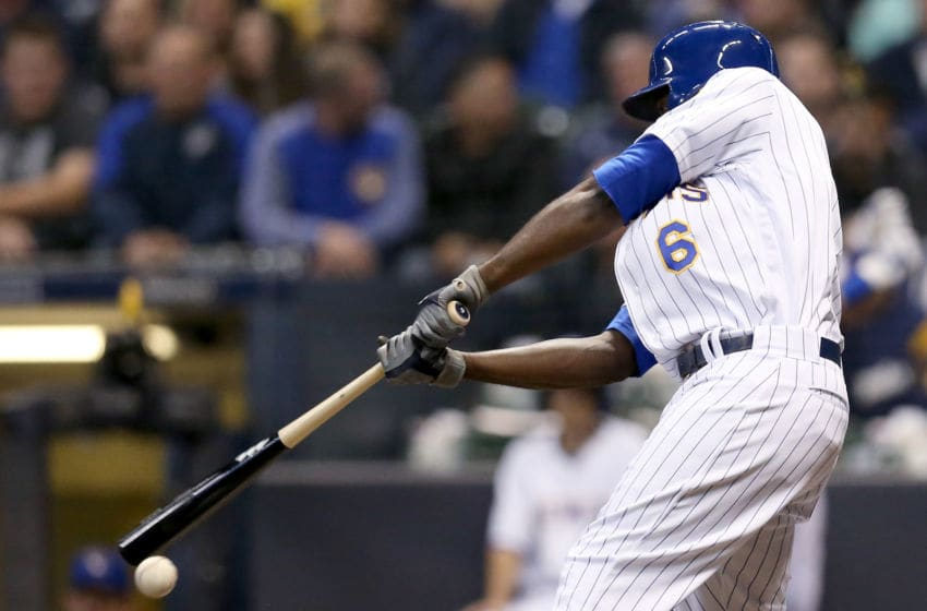MILWAUKEE, WI - SEPTEMBER 29: Lorenzo Cain #6 of the Milwaukee Brewers hits a single in the third inning against the Detroit Tigers at Miller Park on September 29, 2018 in Milwaukee, Wisconsin. (Photo by Dylan Buell/Getty Images)