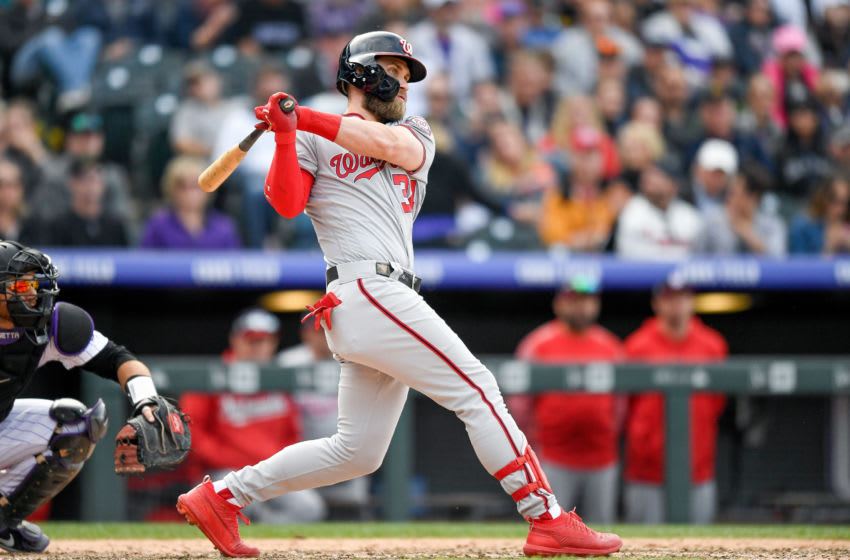 DENVER, CO - SEPTEMBER 30: Bryce Harper #34 of the Washington Nationals hits a ninth inning double against the Colorado Rockies at Coors Field on September 30, 2018 in Denver, Colorado. (Photo by Dustin Bradford/Getty Images)