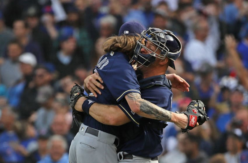 CHICAGO, IL - OCTOBER 01: Erik Kratz #15 of the Milwaukee Brewers (R) hugs Josh Hader #71 after a win over the Chicago Cubs in the National League Tiebreaker Game at Wrigley Field on October 1, 2018 in Chicago, Illinois. The Brewers defeated the Cubs 3-1 to win the Central Division. (Photo by Jonathan Daniel/Getty Images)